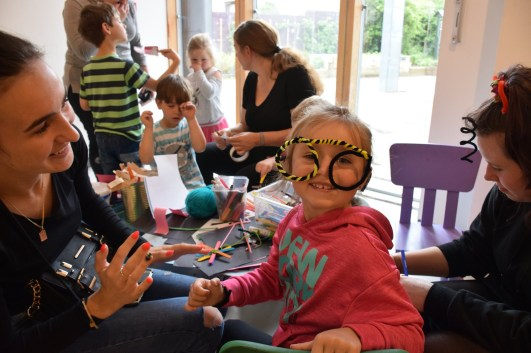 Children and adults in a creative session